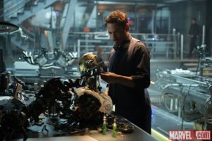 Tony-Stark-Robert-Downey-Jr.-looks-at-robotic-remnants-in-Marvels-Avengers-Age-of-Ultron
